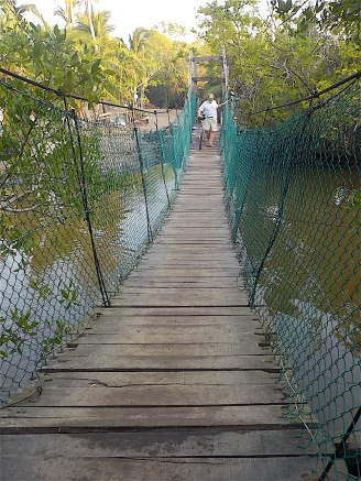 People crossed the swinging bridge over la laguna gingerly