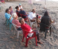 Then, back at the beach bar, who is that hooded guy, anw\yhow?