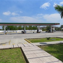 I hesitated to include this shot of a Pemex station, but couldn't resist the repeated patterns and shapes--squares, rectangles, T shapes––and the one round manhole cover. I also love the positions of the attendants next to the gas pumps at the rear of the photo. The clouds are the only soft thing in the photo.