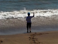 This boy hand casting his line seemed to be either saluting or cursing the ocean.