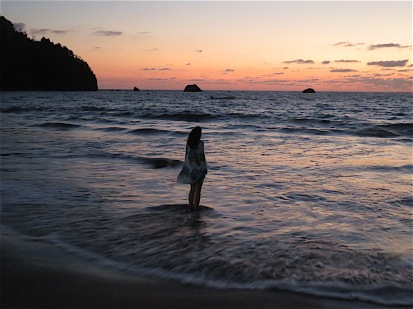 Solitude's mood is much enhanced by sunset and the ripple of a diaphanous dress mirrored by ocean waves.