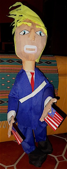 "The King of Chaos. I was on my way to a local hotel/restaurant to read my Trump poem from a few days ago when I saw a woman selling this pinata beside the road. I braked, turned around and went to buy it. A man, seeing me buying it, stopped to buy one as well. ""Does it have anything inside?"" He asked. ""No, you have to cut it open in back and fill it,"" I answered. ""What should we fill it with?"" asked his female companion. ""I'd suggest filling it with baloney,"" I answered. Both the poem and the pinata were a great hit at the reading and the editor of the local paper asked for a copy."