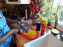 He supervises Yolanda as she chops up peppers and onions to his exacting instructions.