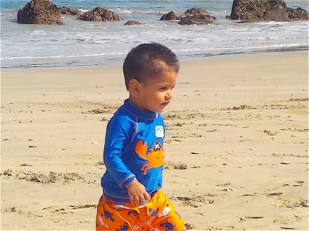 One baby running down the beach