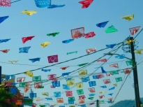 folks looking up at papel picado,
