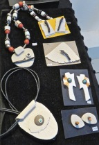 Clay, silver, coral and trade bead necklace and earrings.