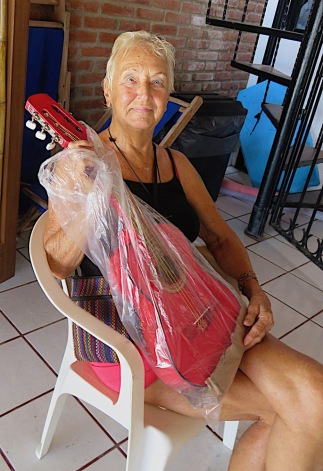 Marjorie Pauline with her mini guitar treasure. She doesn't know how to play!