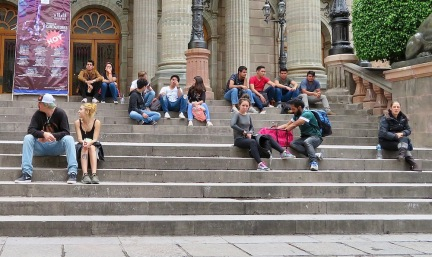 Students congregate on the steps of Teaatro Juarez day and night.