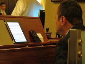 The pianist played his music from his ipad. The next night, Ryan told me to look. He was watching a novella with subtitles as he played! We talked to him afterwards. He says it is no problem for him to split his mind and do the two things at once. I think it is amazing!