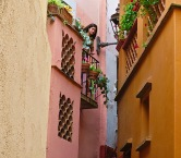 This is the kissing alley. These two balconies were so close that lovers could lean across for a rendezvous. Legend says that a father killed his own daughter when he discovered she'd been meeting a young man below her in the social order from the balcony where you see the girl in this photo.