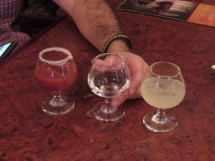 """Carlos Jr's favorite drink, """"La Bandera"""" or flag.. since it is the colors of the Mexican flag. The salted glass is sangrita, the white or clear one is tequila and the green is key lime juice. He alternated sips of each."""