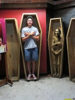 This display was actually set up for this purpose. So macabre, but Ryan got in the spirit. Note the difference in size between the coffins of that day and ones necessary to accomodate the giants of today.