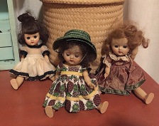 These little dolls sold for $2 each at the Super Value Grocery in the town I grew up in. They were displayed on the shelf over the vegetables. I think these were original outfits.