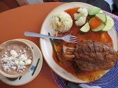 Then Isidro had pork shank