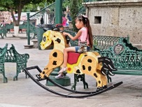 Huge rocking horses in the square were rarely riderless.