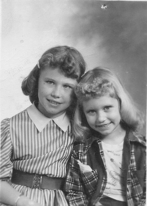 Our sisterly school photo. I was in the first grade. She was in the fourth. I inherited that dress!