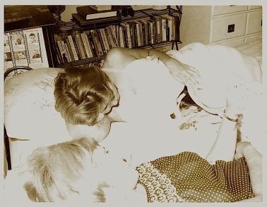 Scamp and I invading sister Patti's bed on a Saturday morning.