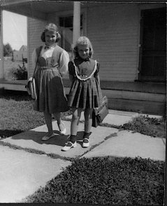 Our first day of school. I believe I was seven and she was eleven.