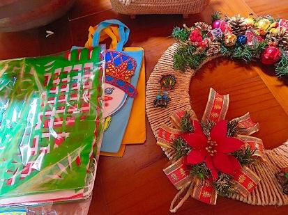 Papel picado banner unhung, Xmas bags unstuffed, wreath unhung.