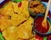 Nachos with salsa and refried beans.