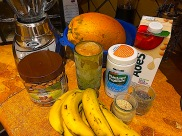 Papaya and banana smoothie blended with bran, almonds, Psyllium, ground flax seed, chia, green apple soy milk and ice. I've had a variation of this smoothie every morning for at least 25 years.