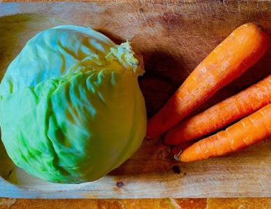 Finely shred and then chop 1/2 head cabbage and three or four carrots.