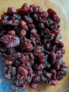 Chop up 1 cup dried cranberries,