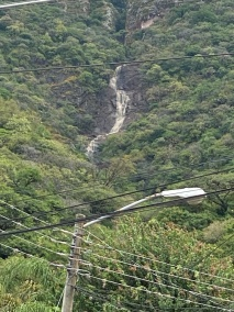 This huge waterfall is still thundering down the mountainside--one of three created by the recent rains.t