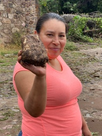 This is a huge camote that washed down the arroyo. Patti will wash the mud off and cook it for dinner.